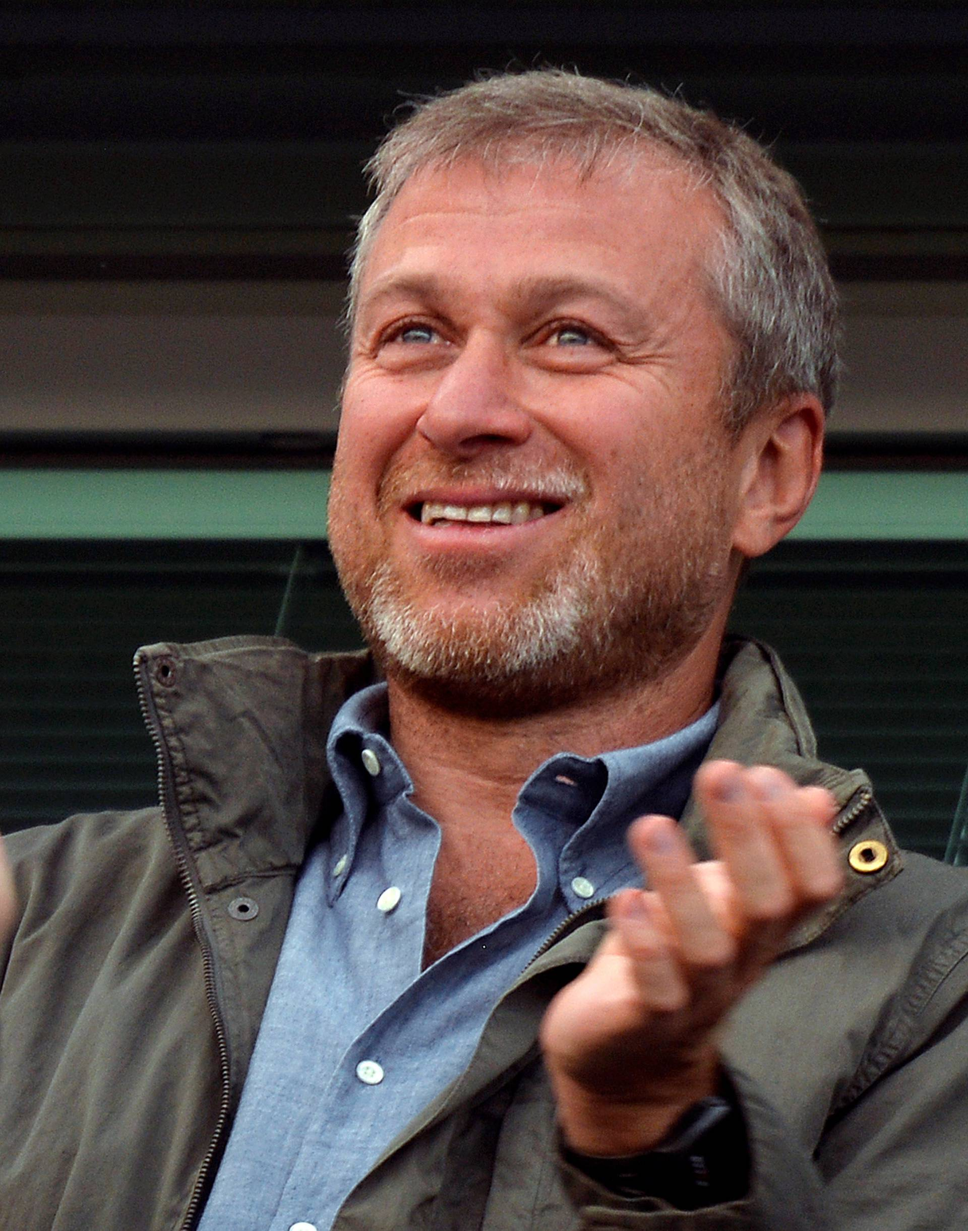 FILE PHOTO: Chelsea owner Roman Abramovich applauds after the English Premier League soccer match between Chelsea and Hull City in London