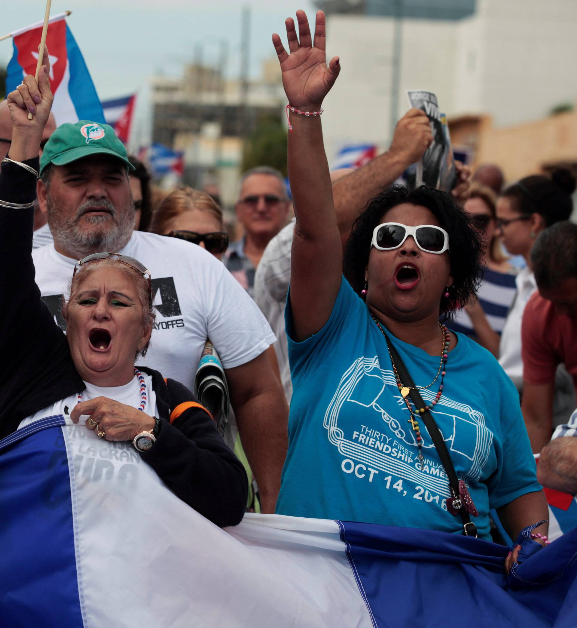 People celebrate after the announcement of the death of Cuban revolutionary leader Fidel Castro in the Little Havana district of Miami