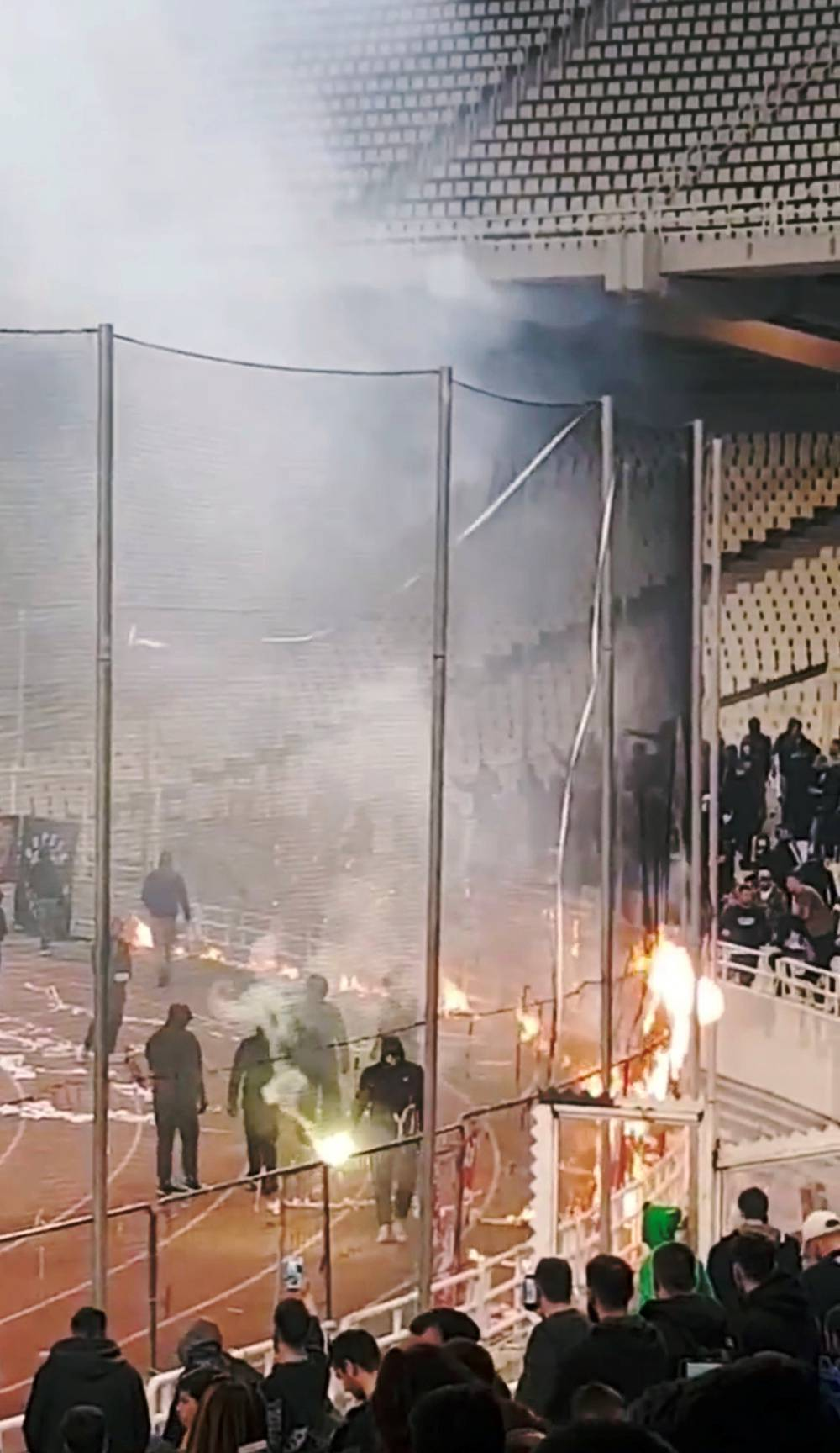 Panathinaikos fans burn flags during their Super League match at the OAKA Spiros Louis stadium in Athens