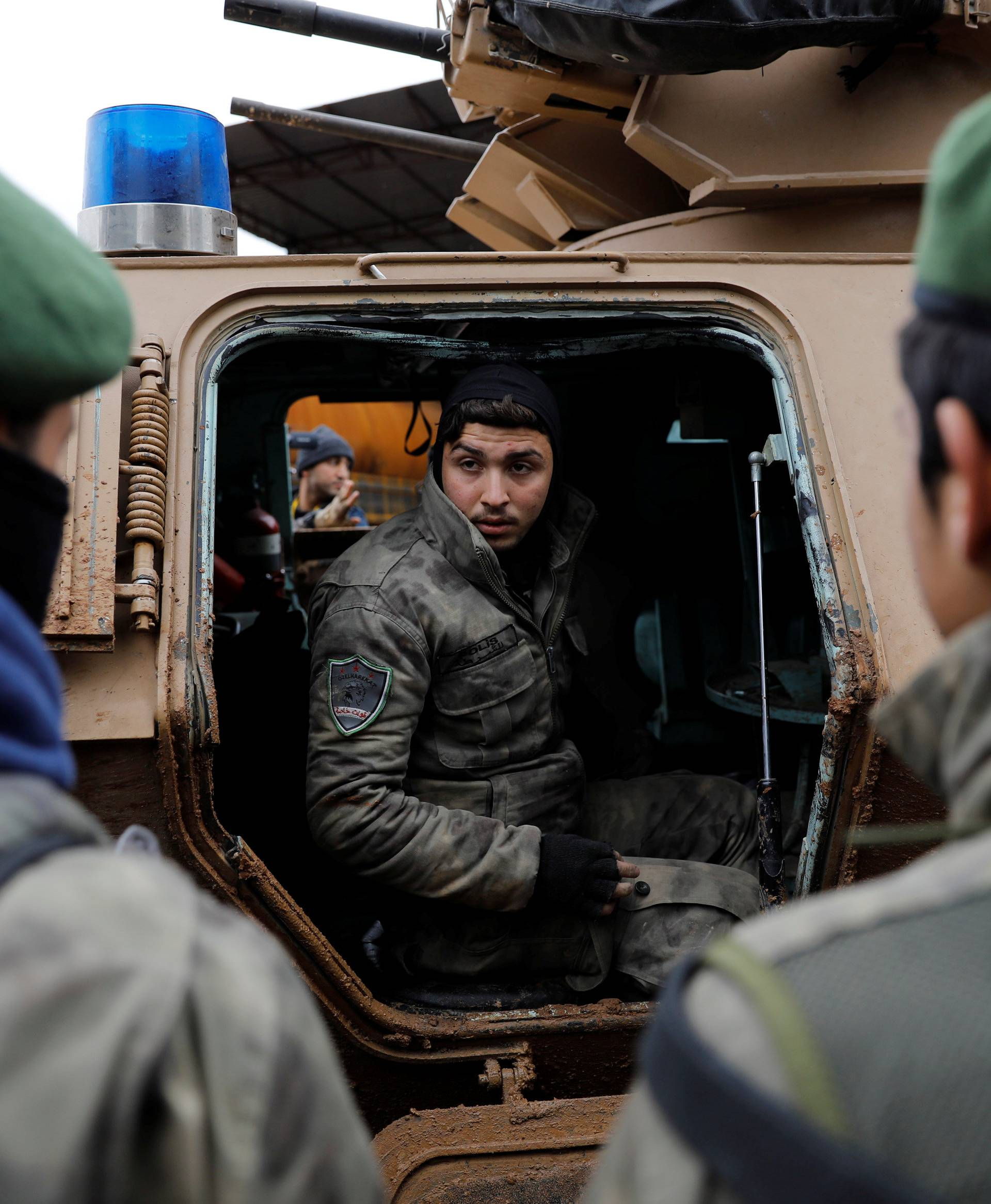 Turkey-backed Free Syrian Army police forces  escort a convoy near Azaz