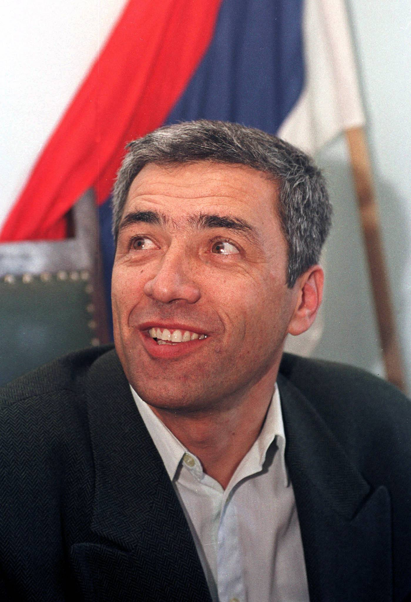 FILE PHOTO - The leader of the Serb community Oliver Ivanovic smiles as he speaks to the press in his office in Mitrovica