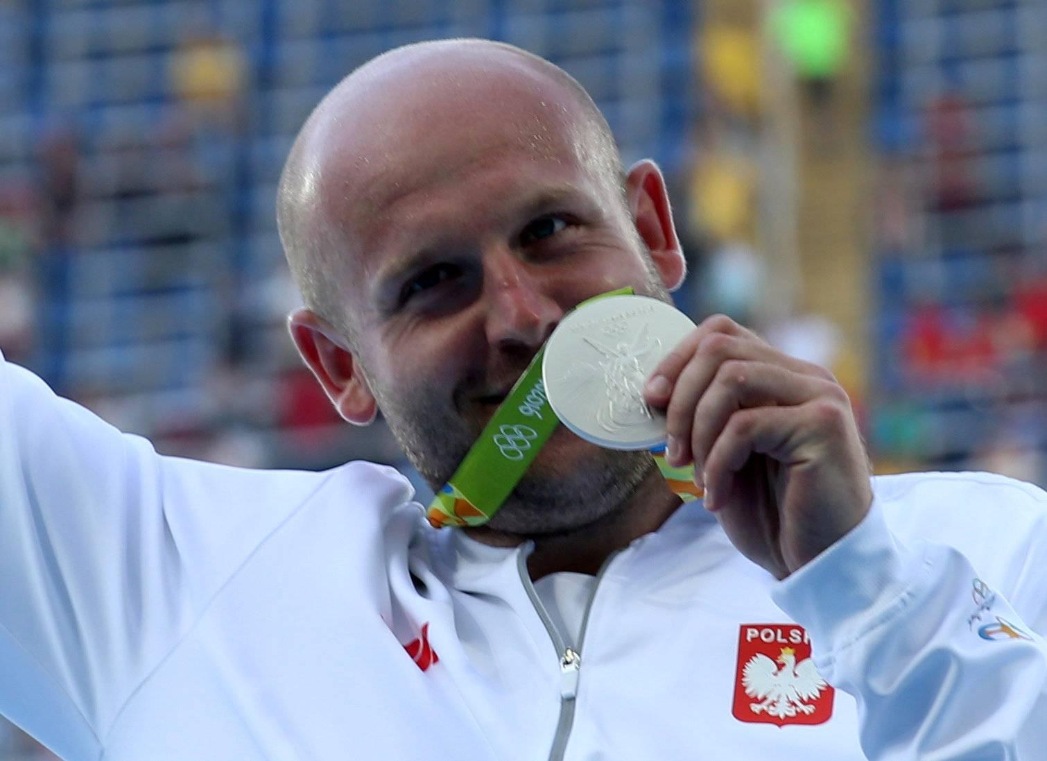 Athletics - Men's Discus Throw Victory Ceremony
