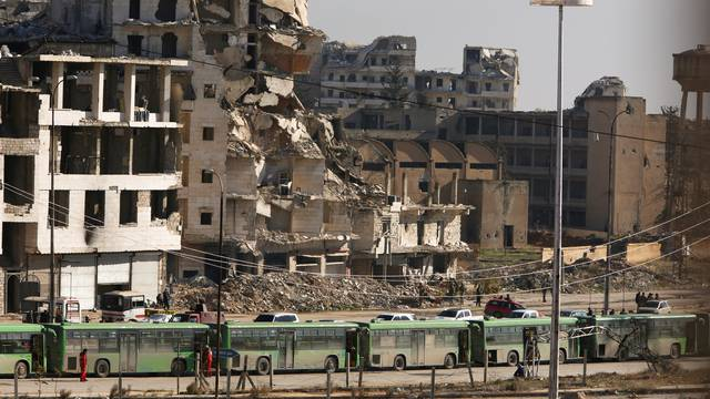 Buses are seen parked in Aleppo's government controlled area of Ramouseh, as they wait to evacuate civilians and rebels from eastern Aleppo