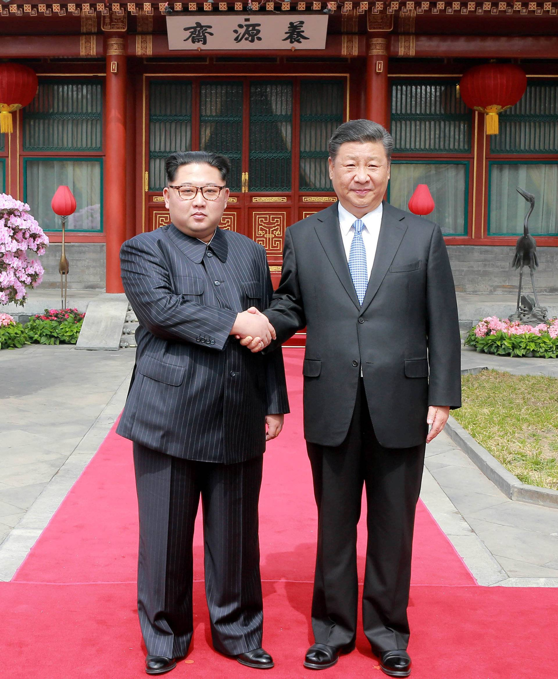 North Korean leader Kim Jong Un shakes hands with Chinese President Xi Jinping