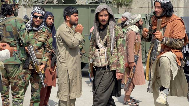 FILE PHOTO: Taliban forces patrol at a runway a day after U.S troops withdrawal from Hamid Karzai International Airport in Kabul