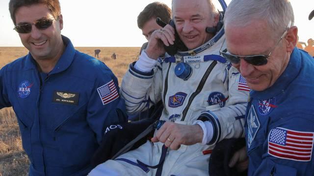 Ground personnel carry the International Space Station (ISS) crew member Jeff Williams of the U.S. after landing near the town of Zhezkazgan (Dzhezkazgan), Kazakhstan