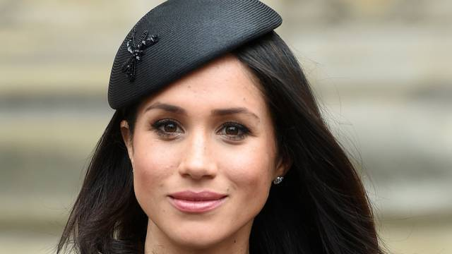 FILE PHOTO: Meghan Markle, the fiancee of Britain's Prince Harry, attends a Service of Thanksgiving and Commemoration on ANZAC Day at Westminster Abbey in London