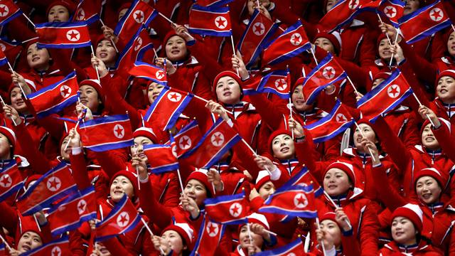 FILE PHOTO: North Korean cheerleaders wave their national flags