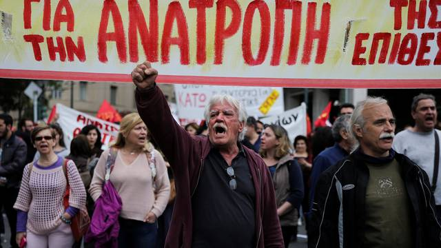 Demonstrators shouts slogans during a demonstration marking a 24-hour general strike against the latest round of austerity in Athens
