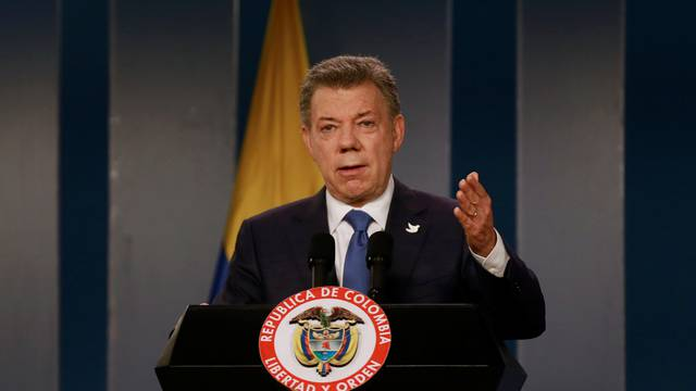 Colombia's President Santos talks during a news conference after a meeting with Colombian former President and Senator Uribe at Narino Palace in Bogota, Colombia