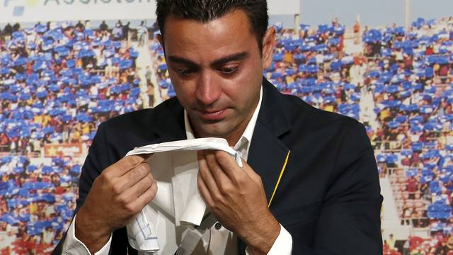 FILE PHOTO: Barcelona's Xavi Hernandez cries during his farewell event at Auditori 1899 in Nou Camp stadium in Barcelona