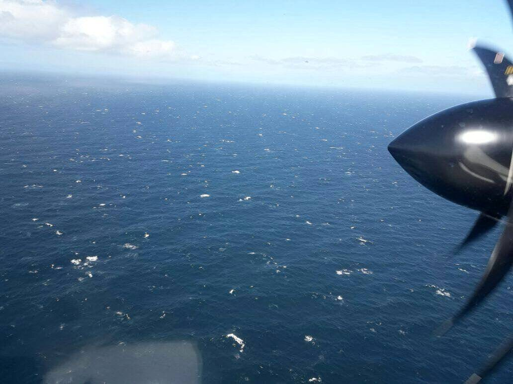 An Argentine Navy airplane is seen as it flies over the Atlantic Ocean during the search for the ARA San Juan submarine missing at sea