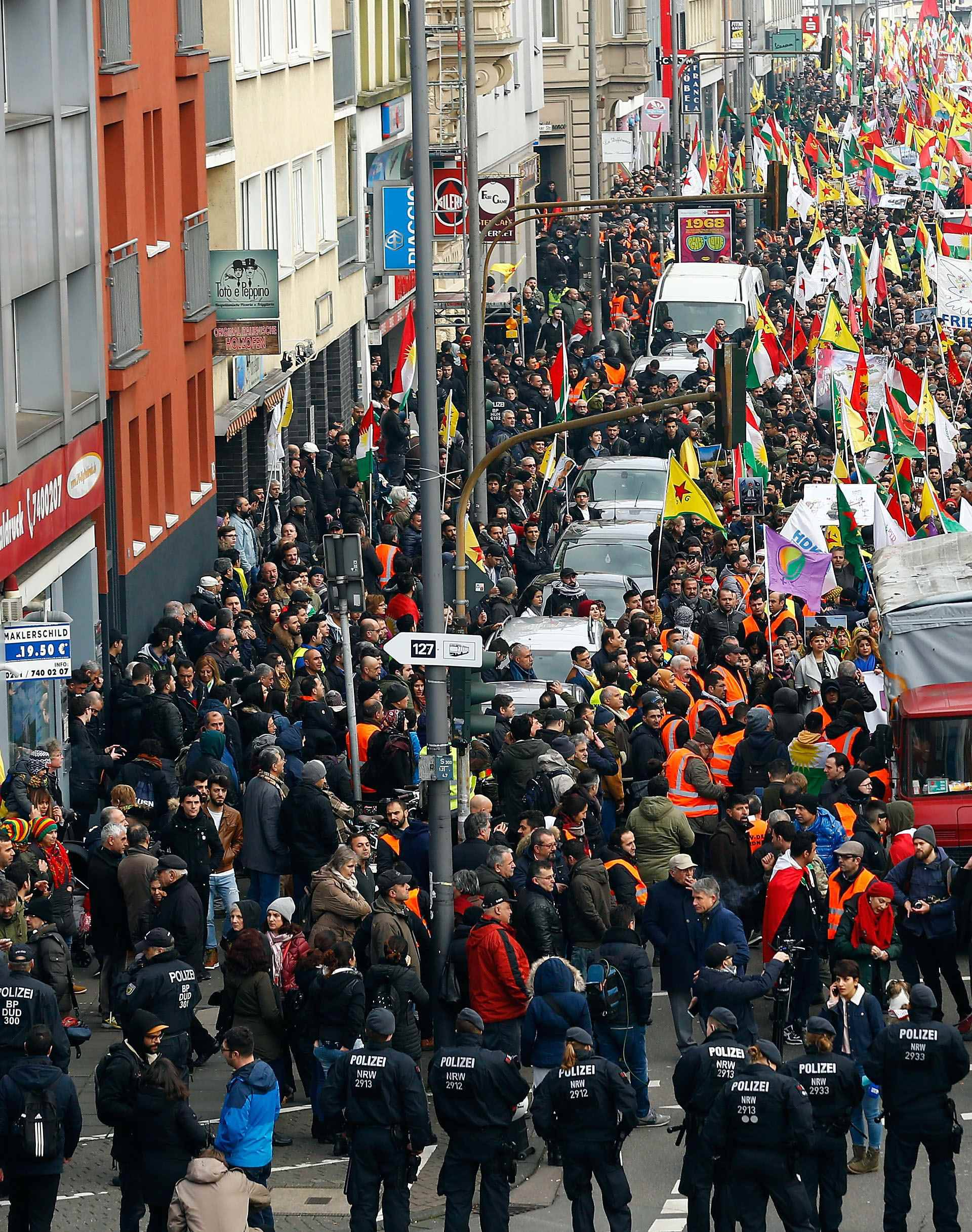 Pro-Kurdish people attend a demonstration in Cologne
