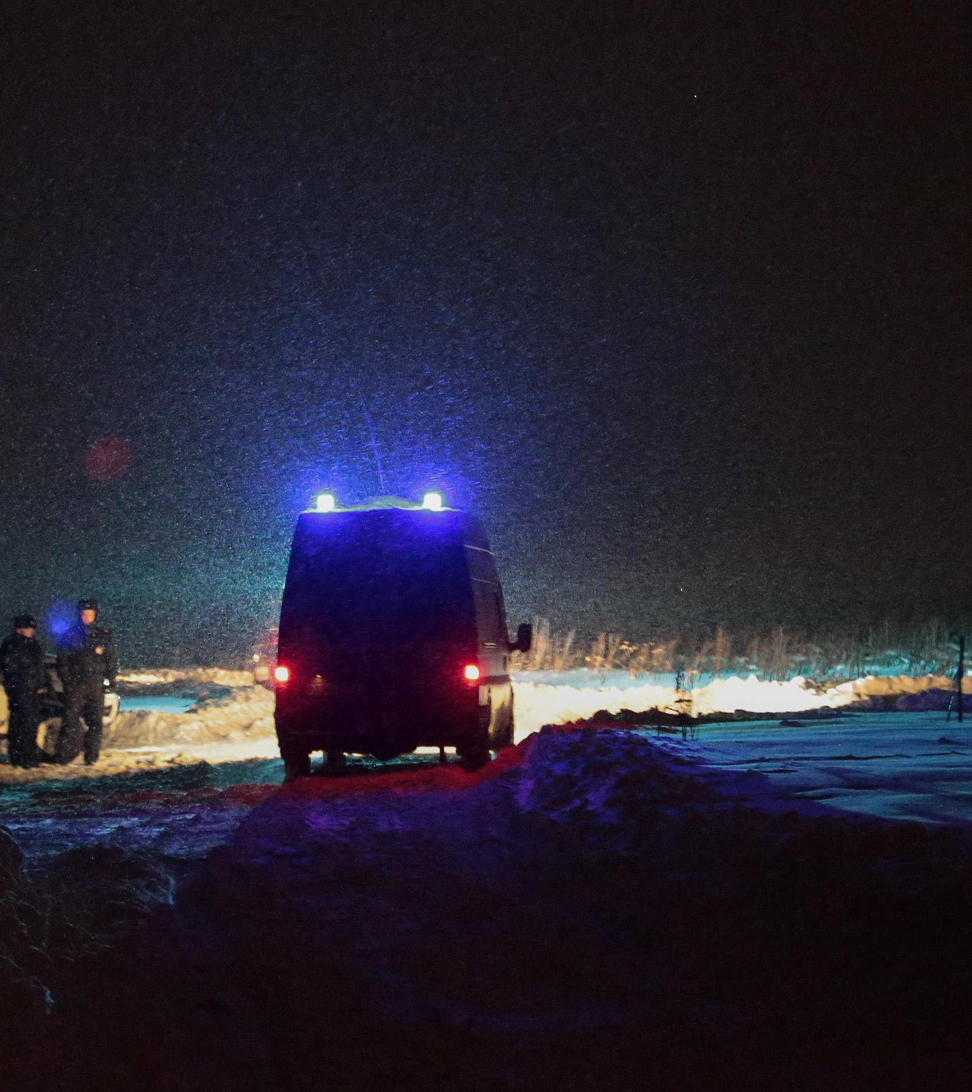 Police officers guard at the scene where a Saratov Airlines Antonov AN-148 plane crashed after taking off from Moscow's Domodedovo airport, outside Moscow