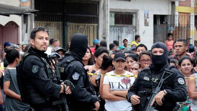 Policemen are seen at a site where, according to local media, an armed group entered and opened fire at a bar, killing and wounding its patrons, in Belem