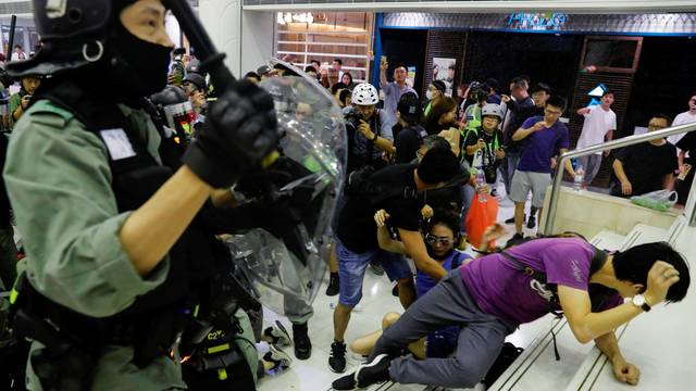 Riot police disperse anti-government protesters at a shopping mall in Tai Po, Hong Kong