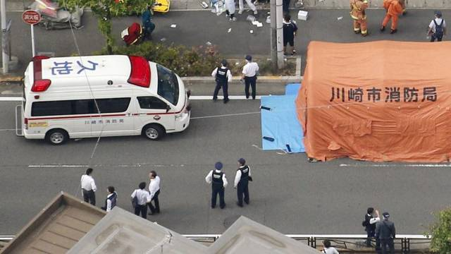 An aerial view shows rescue workers and police officers operate at the site where sixteen people were injured in a suspected stabbing by a man, in Kawasaki