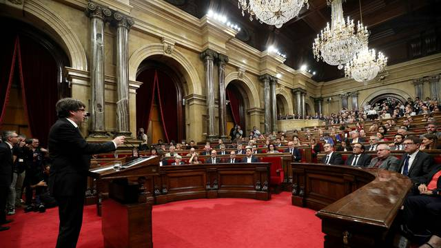 Catalan President Carles Puigdemont speaks in the chamber at the Catalonian regional parliament in Barcelona