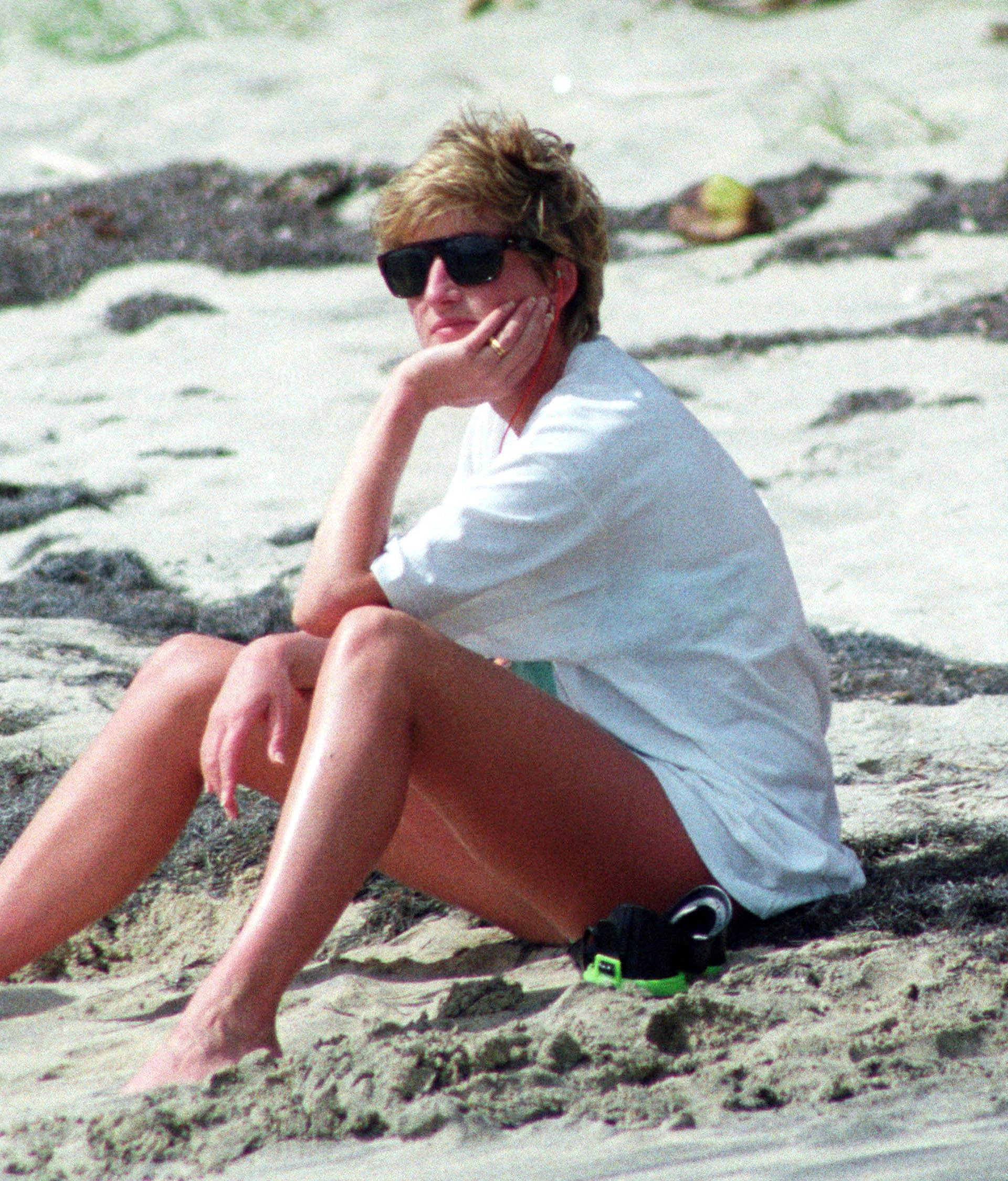 FILE PHOTO: Princess Diana relaxes on the sand during a visit to the beach on the Caribbean Island of Nevis