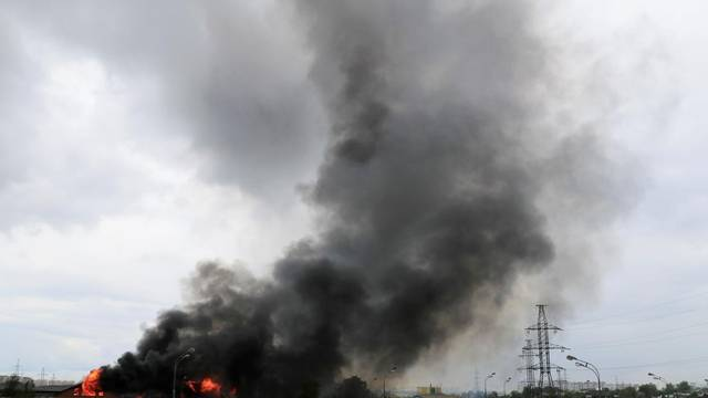 Flames and smoke rise from a fire at an electricity generating power station in Moscow region