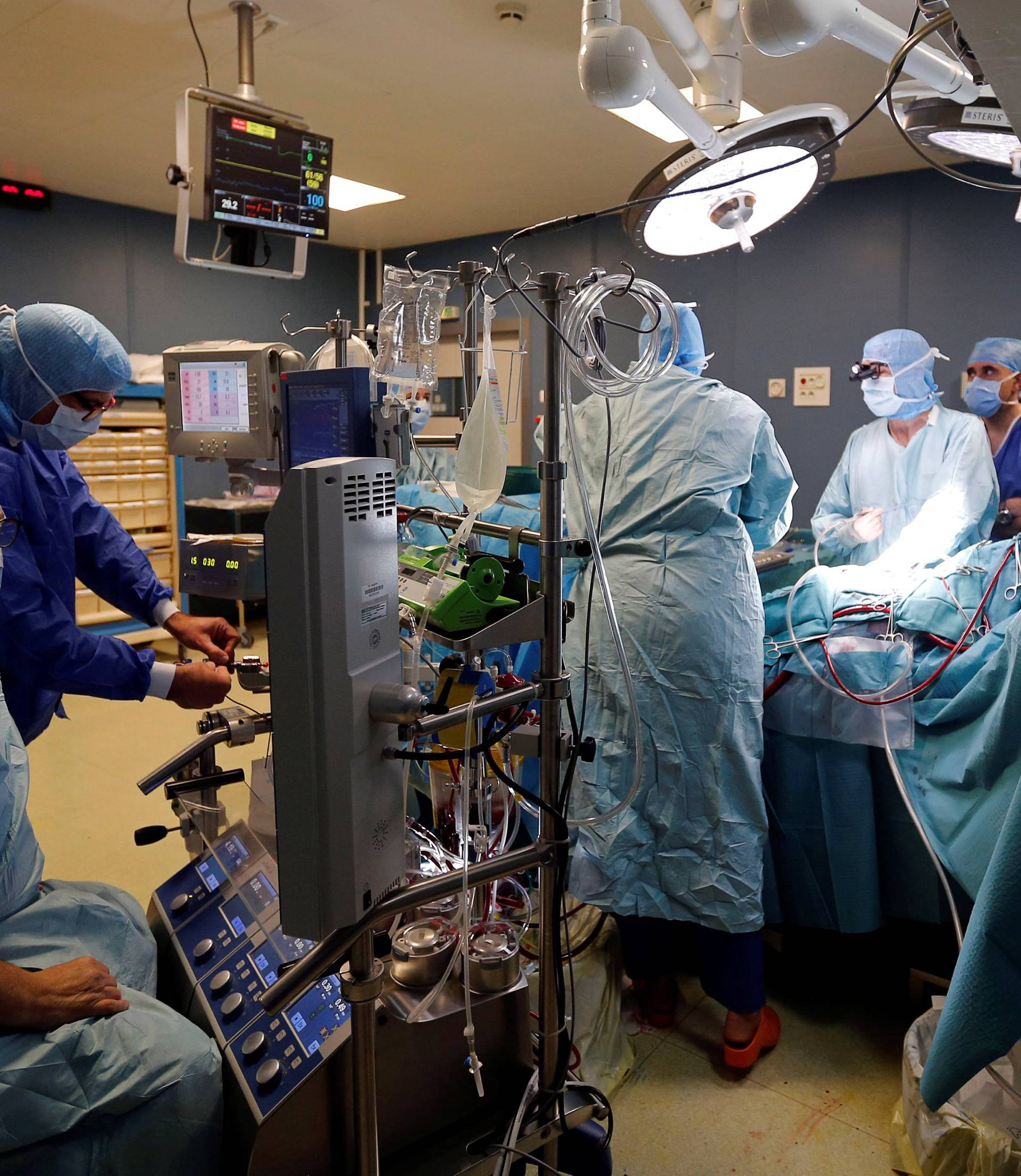 Medical team perform a heart surgery in an operating room at the Saint-Augustin clinic in Bordeaux