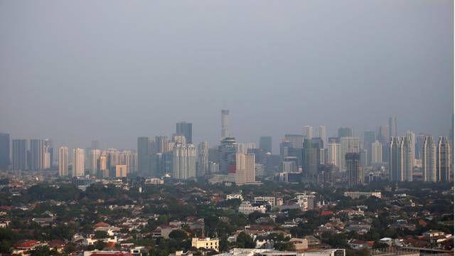 A combination picture shows a general view of high-rise buildings in Jakarta