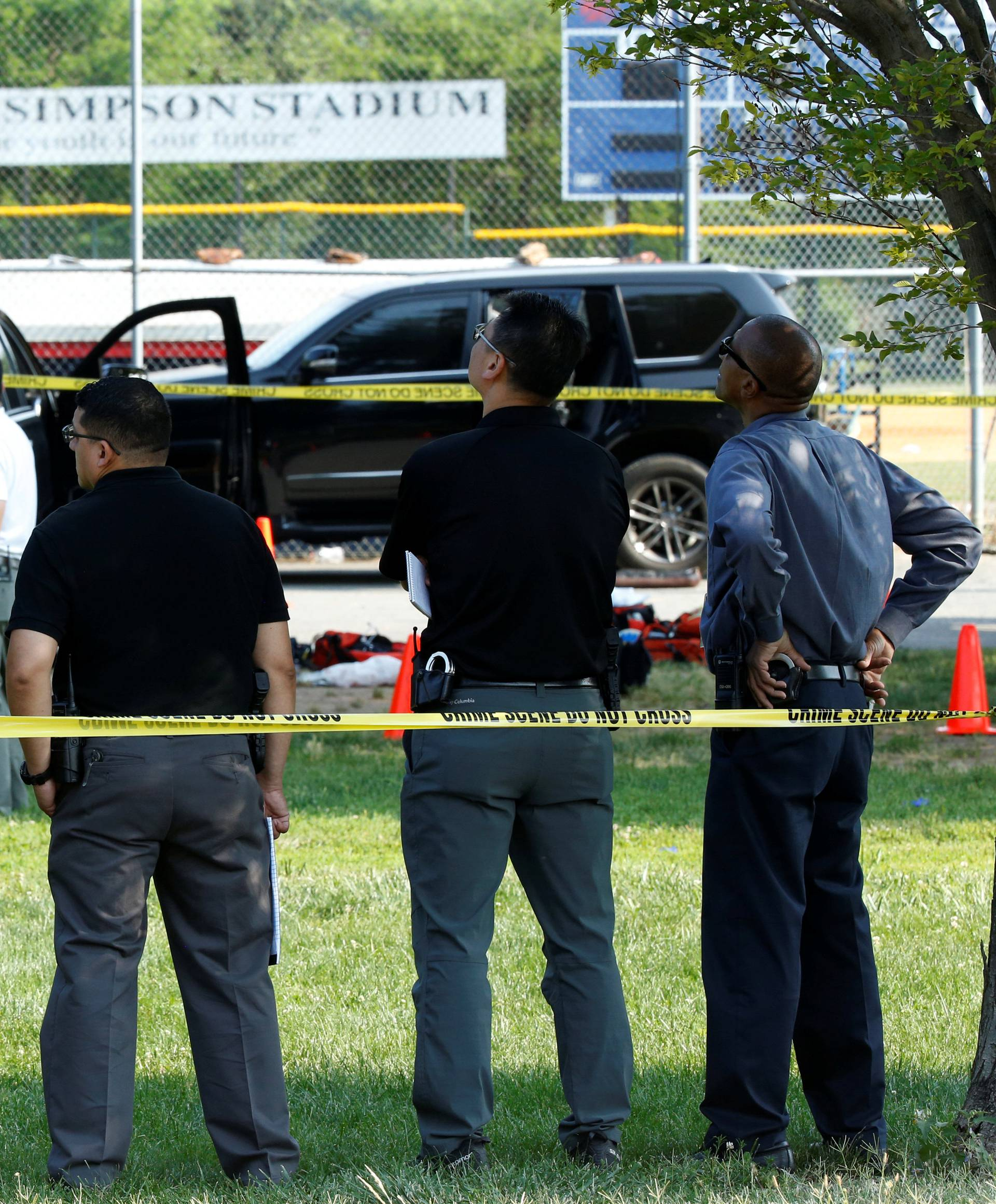 Police investigate the shooting scene after a gunman opened fire on Republican members of Congress during a baseball practice in Alexandria, Virginia