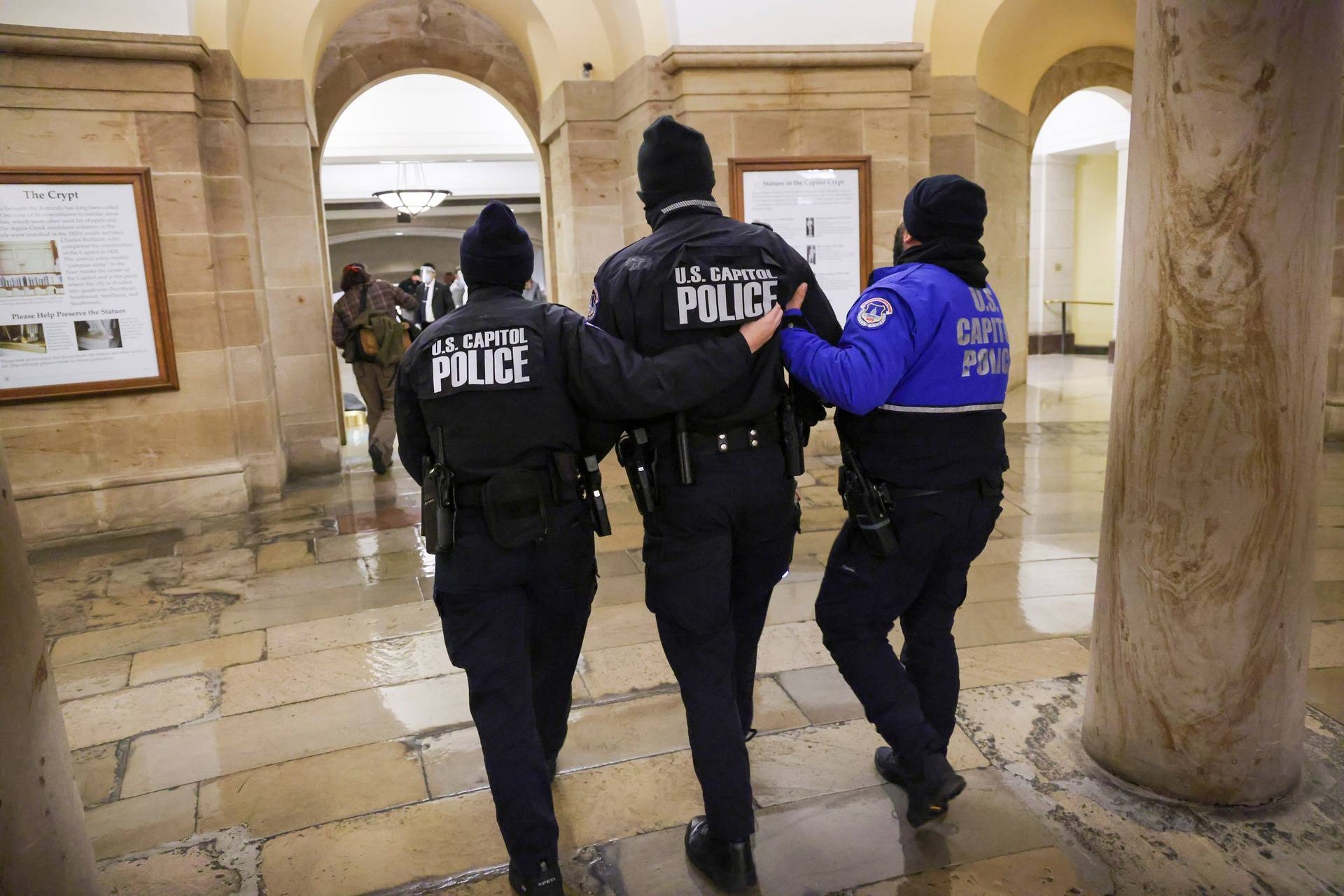 Members of the U.S. Capitol Police walk inside the Capitol as supporters of U.S. President Donald Trump protest outside, in Washington