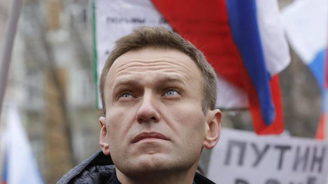 Russian opposition leader Alexei Navalny attends a rally in memory of politician Boris Nemtsov in Moscow