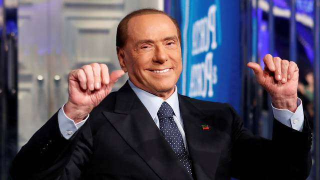 "FILE PHOTO: Italy's former Prime Minister Silvio Berlusconi gestures during the taping of the television talk show ""Porta a Porta"" (Door to Door) in Rome"