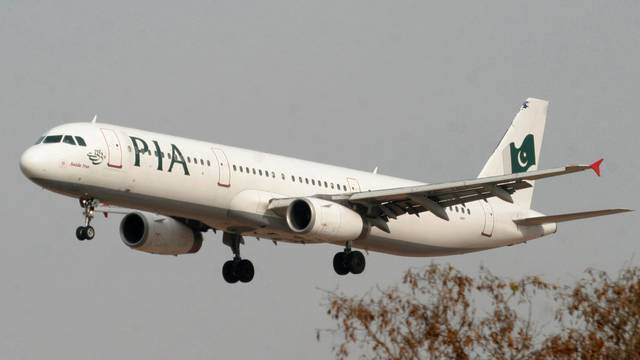FILE PHOTO: A Pakistan International Airlines plane prepares to land at Islamabad airport in Islamabad