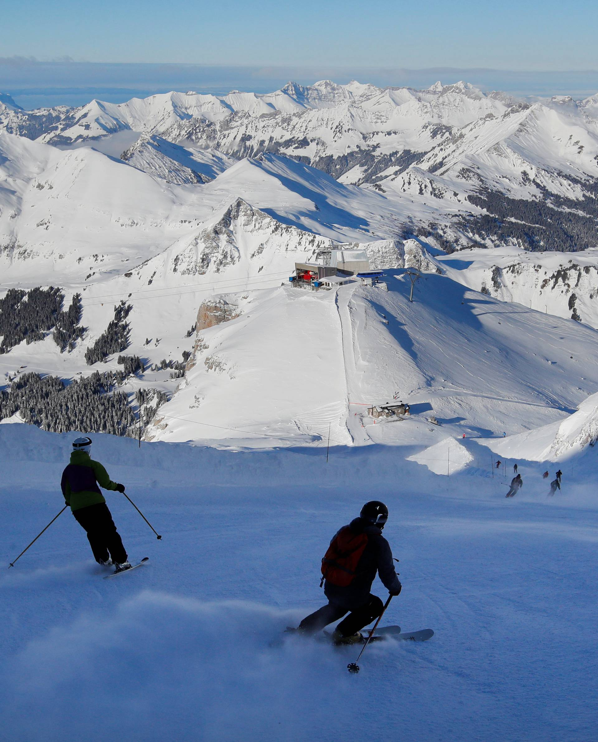 Guests speed down the Red Run during its official opening at Glacier 3000 in Les Diablerets