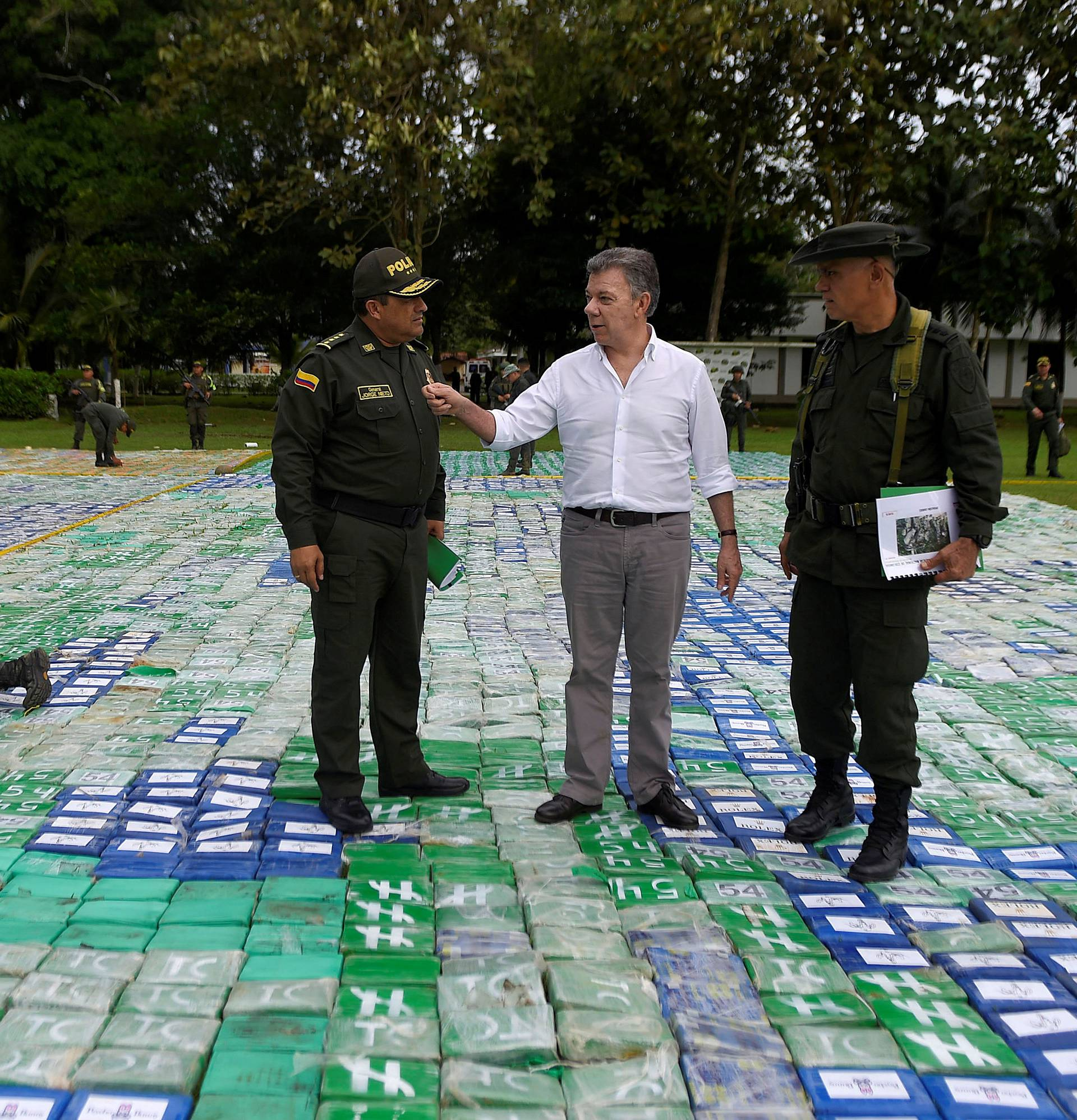 Colombia's President Juan Manuel Santos looks on after the seizure of more than 12 tons of cocaine in Apartado, Colombia