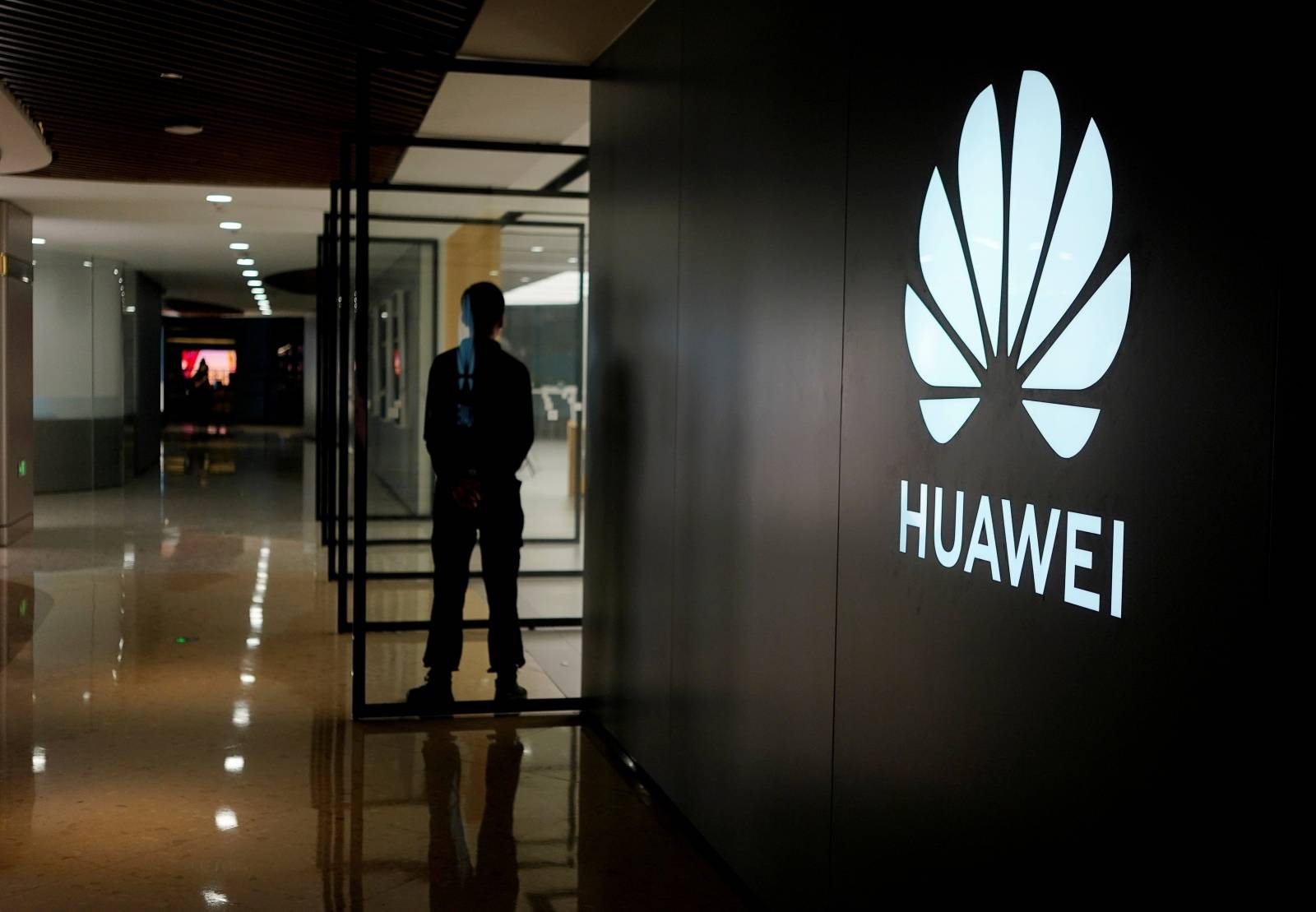 FILE PHOTO: A Huawei company logo is seen at a shopping mall in Shanghai