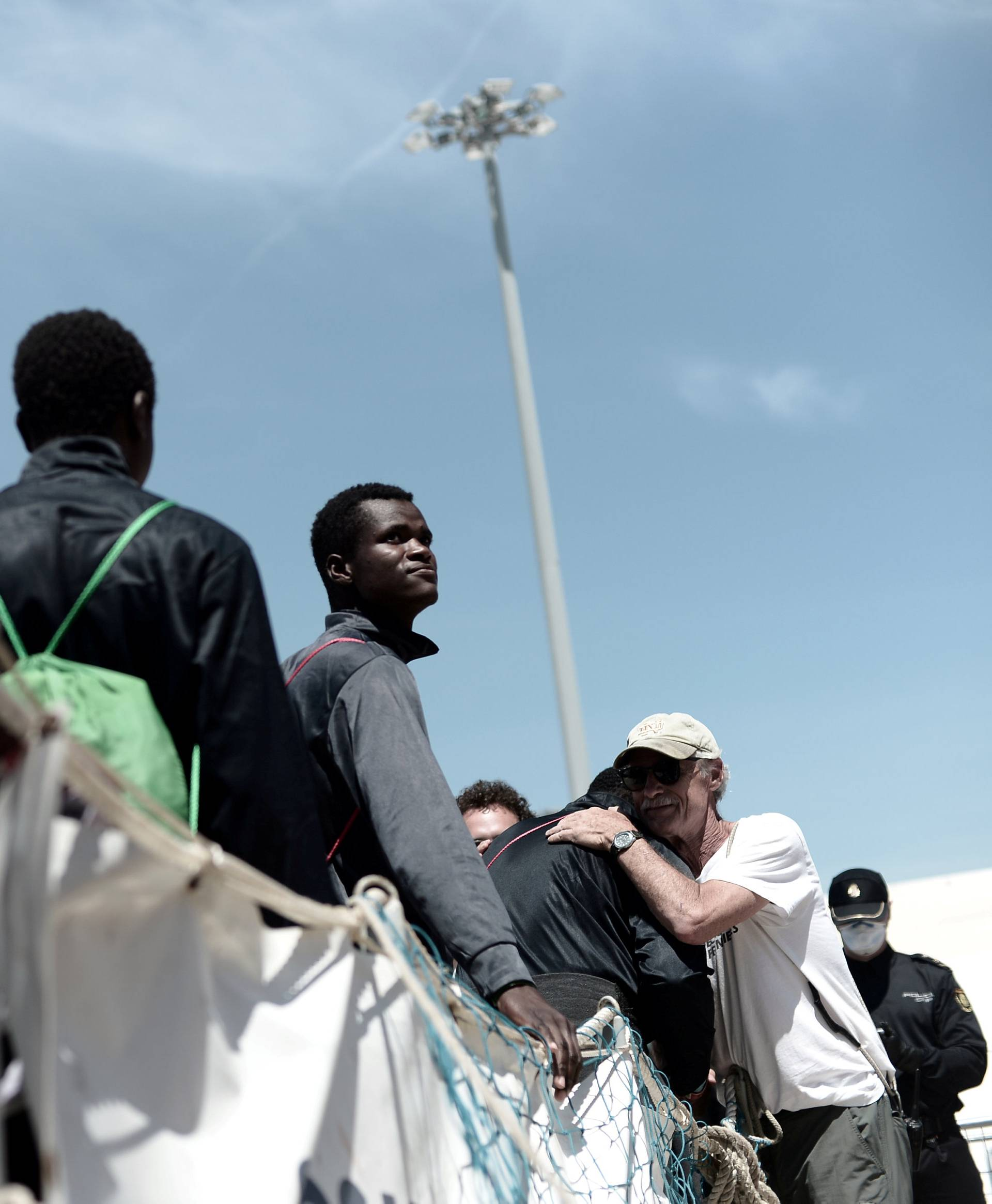 Migrants disembark from the Aquarius rescue ship after arriving to port in Valencia