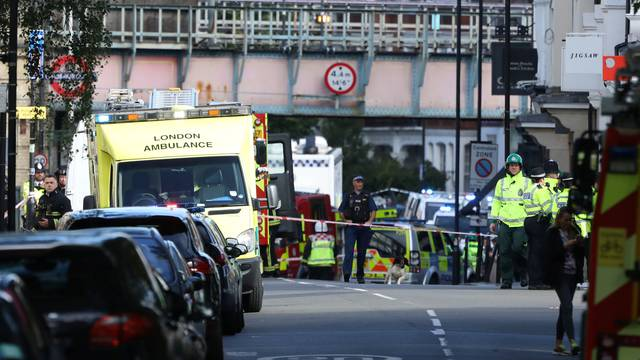 Police, fire and ambulance crew attend to an incident at Parsons Green underground station in London