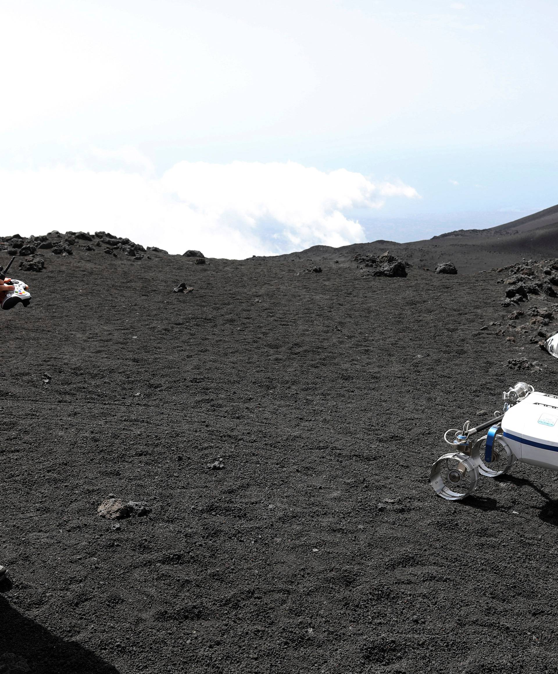 A scientist from German Aerospace Center controls a robot on the Mount Etna