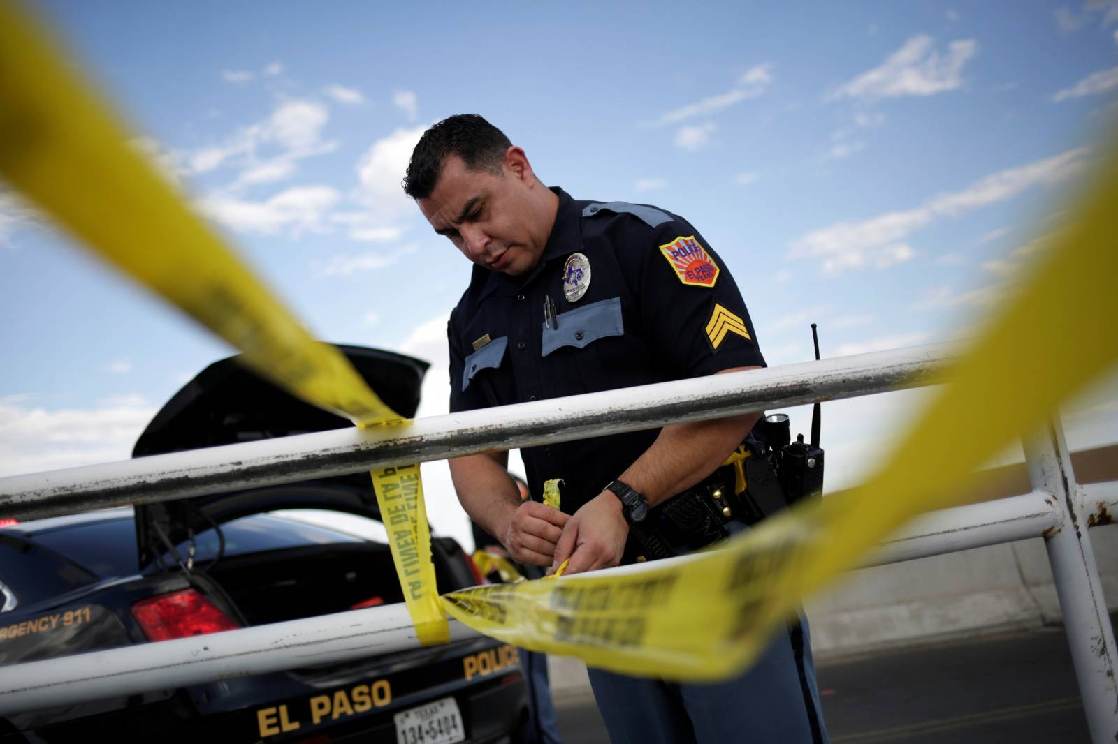 A police cordon is seen after a mass shooting at a Walmart in El Paso