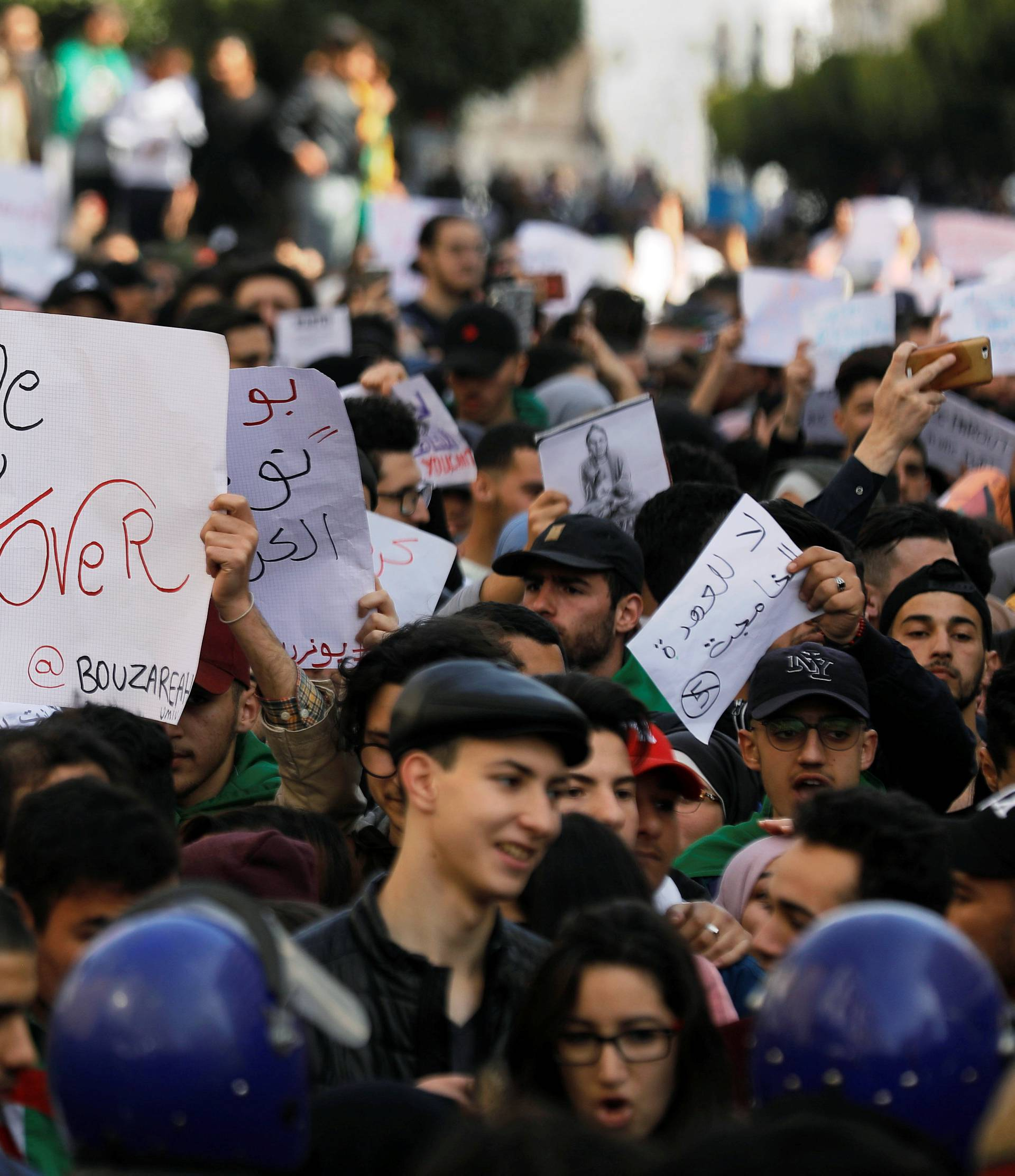 Students take part in a protest to denounce an offer by President Abdelaziz Bouteflika to run in elections next month but not to serve a full term if re-elected, in Algiers