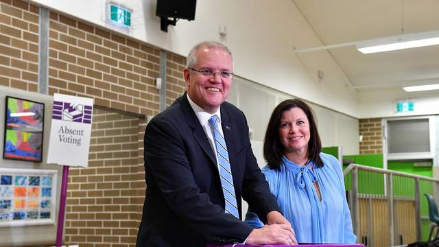 Australian Prime Minister Scott Morrison casts his vote alongside wife Jenny, on Election day, at Lilli Pilli Public School, in Sydney