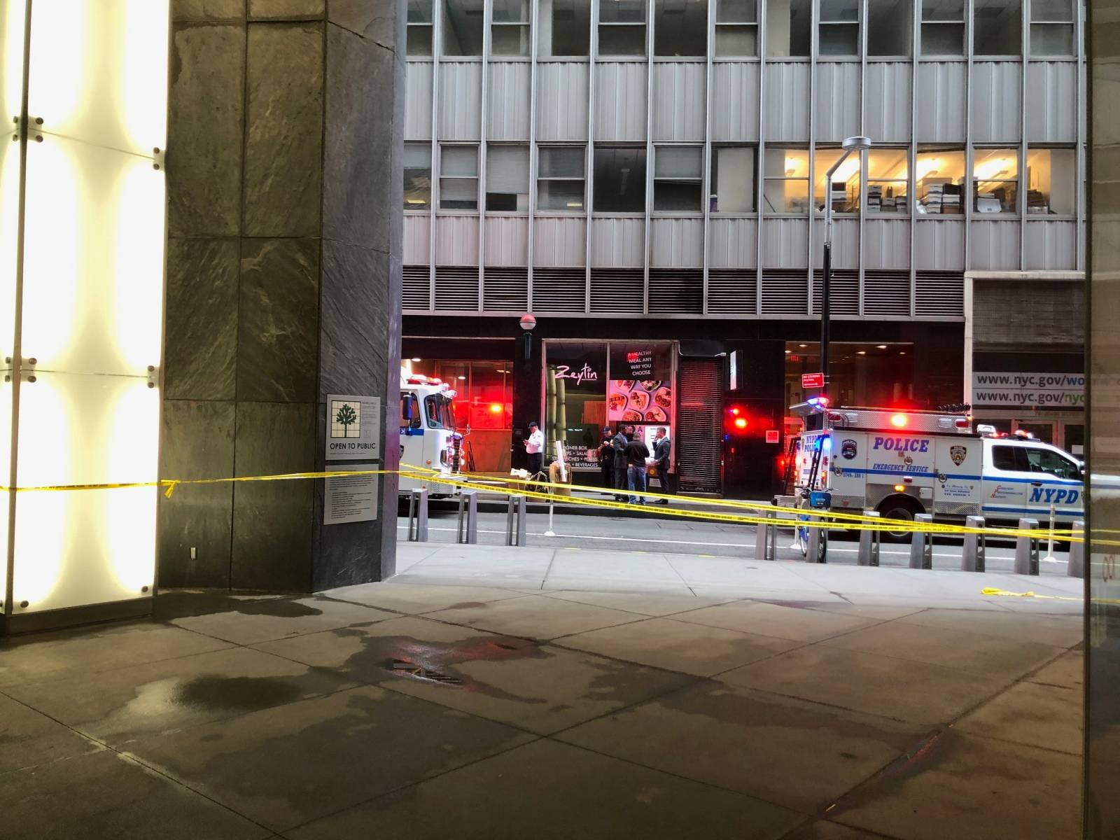 NYPD vehicles are seen in a restricted area after an incident at the Fulton St. subway station in Manhattan, New York
