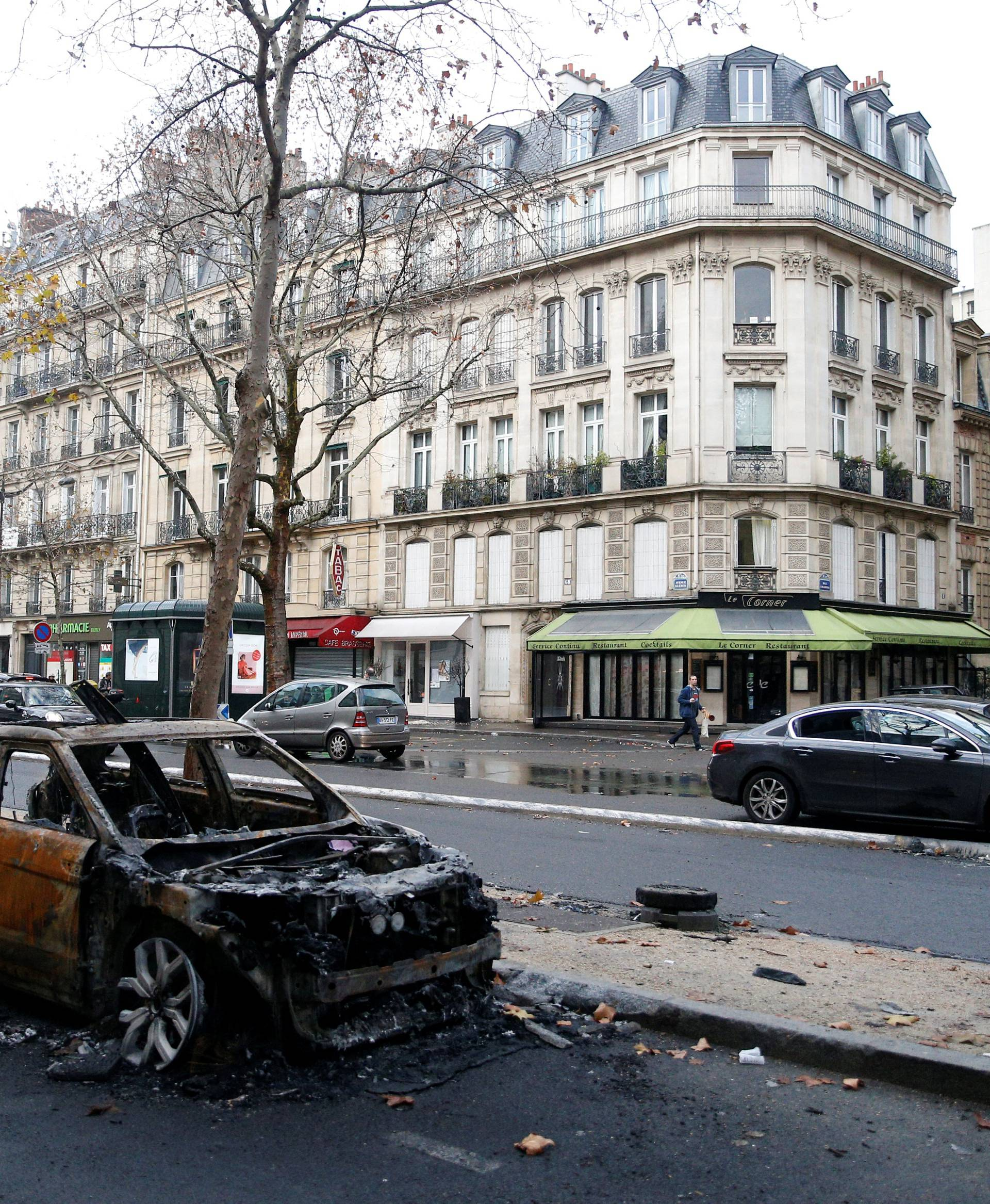 A vandalized car is seen the morning after clashes with protesters wearing yellow vests, a symbol of a French drivers' protest against higher diesel taxes, in Paris