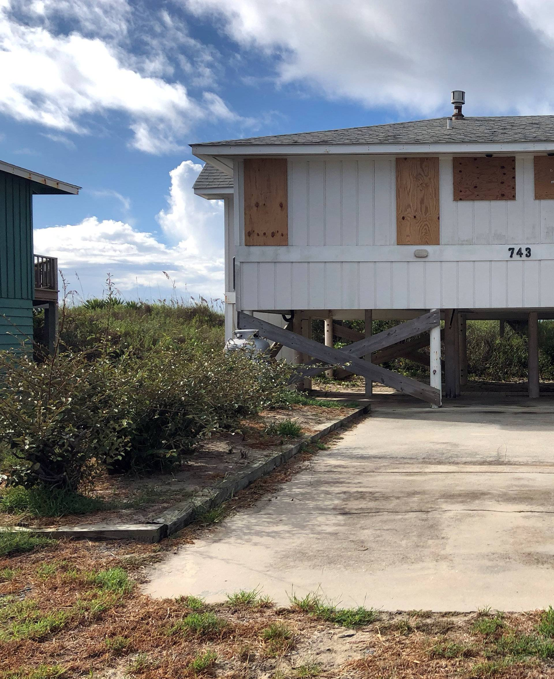 A beachfront home is boarded up ahead of Hurricane Florence, at Holden Beach
