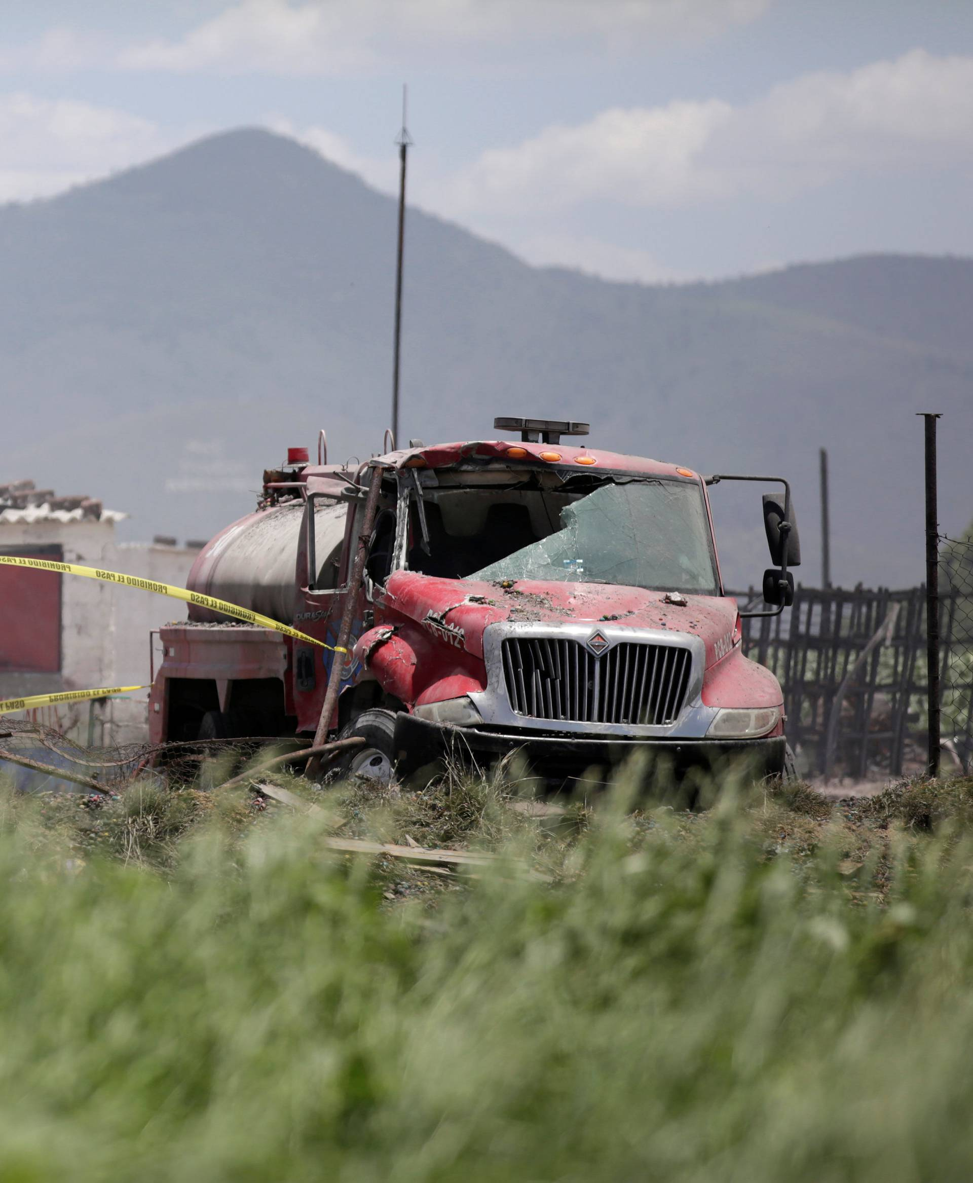 A forensic technician inspects a site damaged due to fireworks explosions in the municipality of Tultepec