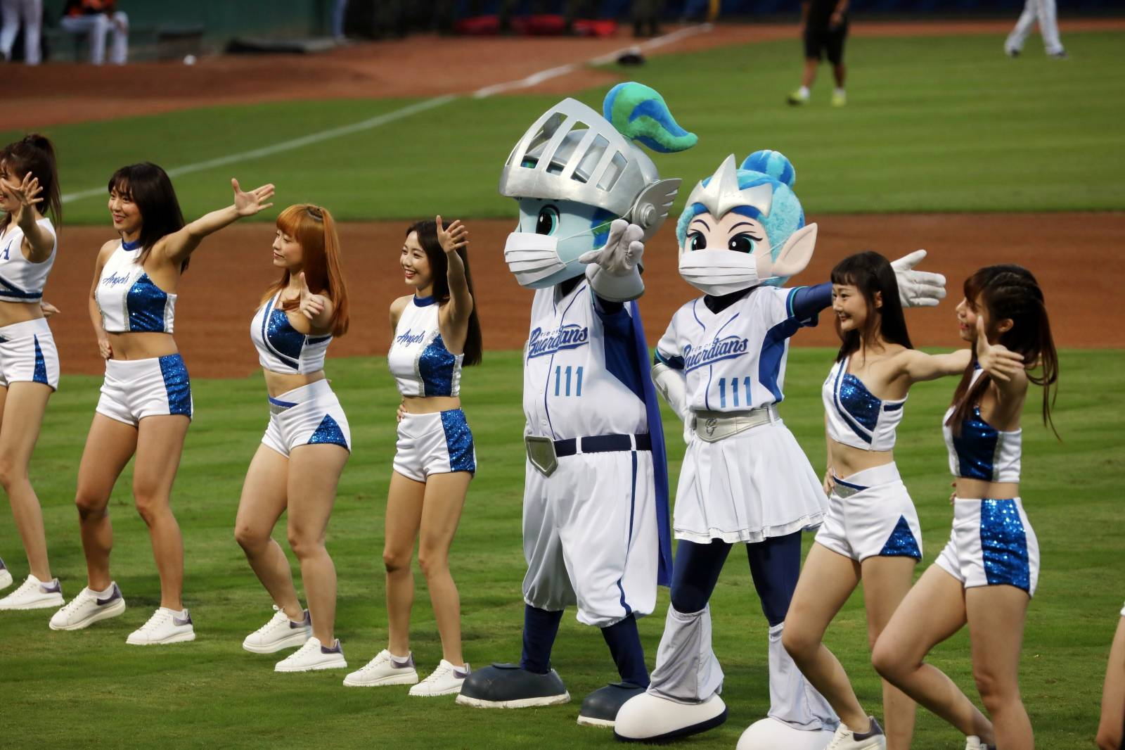 Mascots of a baseball team dance while wearing face masks at the first professional league game that allow audience since the outbreak of the coronavirus disease (COVID-19) in Taipei
