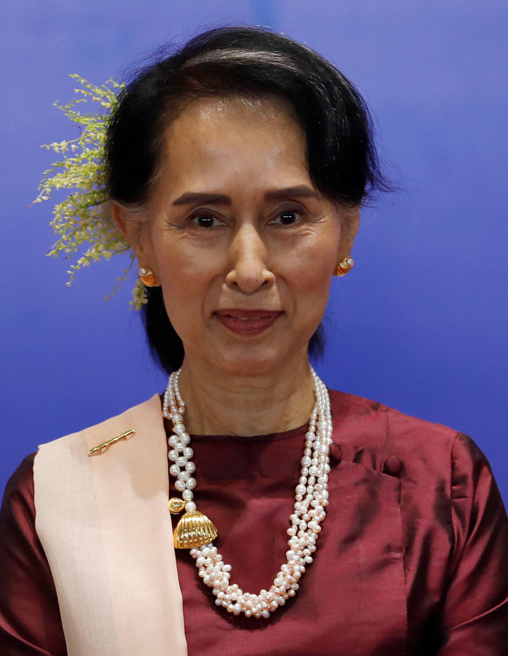 State Councilor Aung San Suu Kyi (C) poses for a photo at a photo session during the Second Anniversary of Nationwide Ceasefire Agreement (NCA) in Naypyitaw