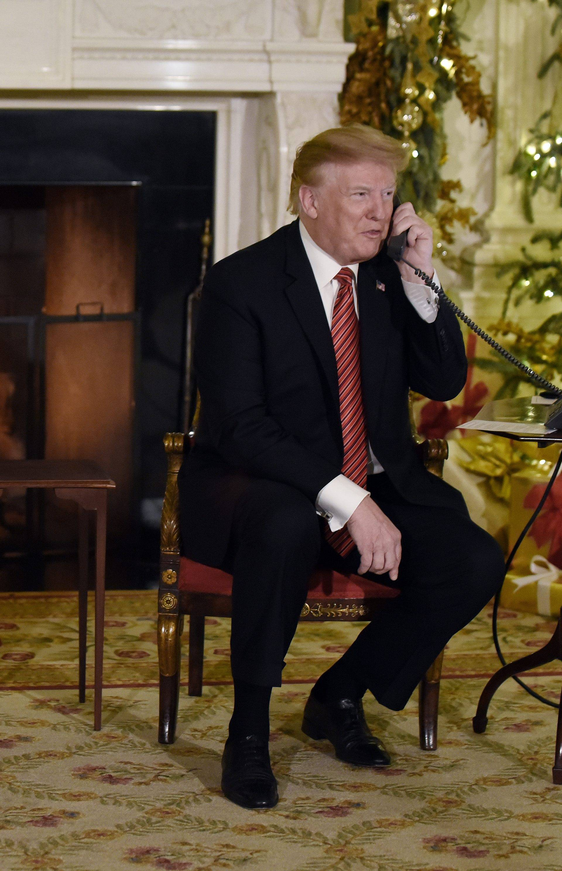 US President Donald J. Trump and first lady Melania Trump participate in NORAD Santa Tracker phone calls