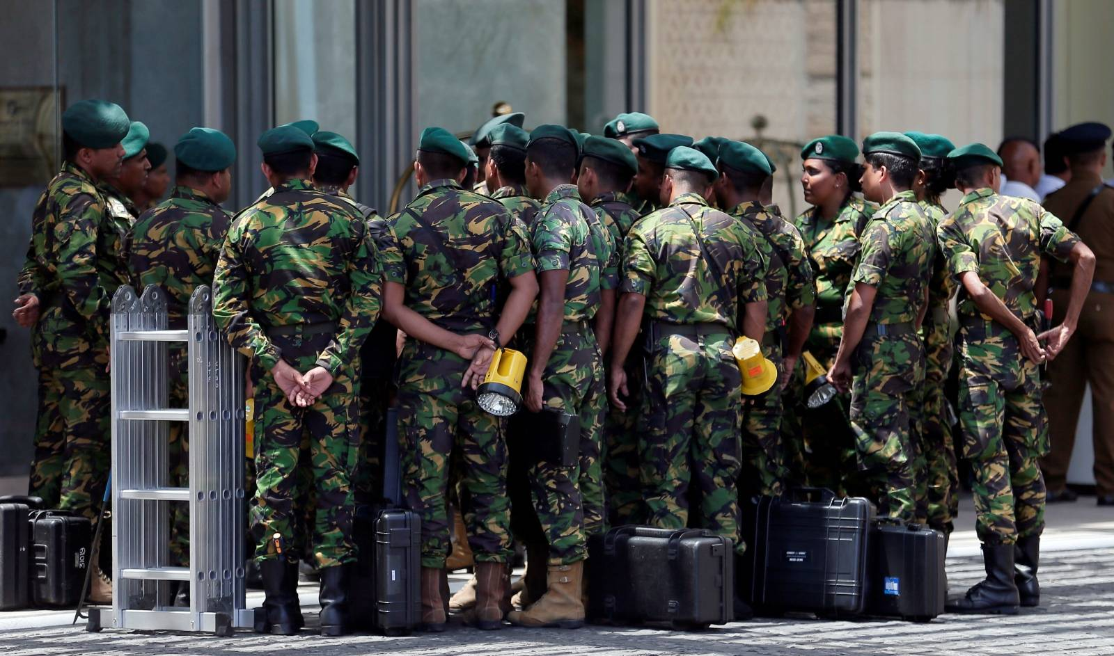 Special Task Force members prepare to go to the site of an explosion at Shangri-La hotel in Colombo