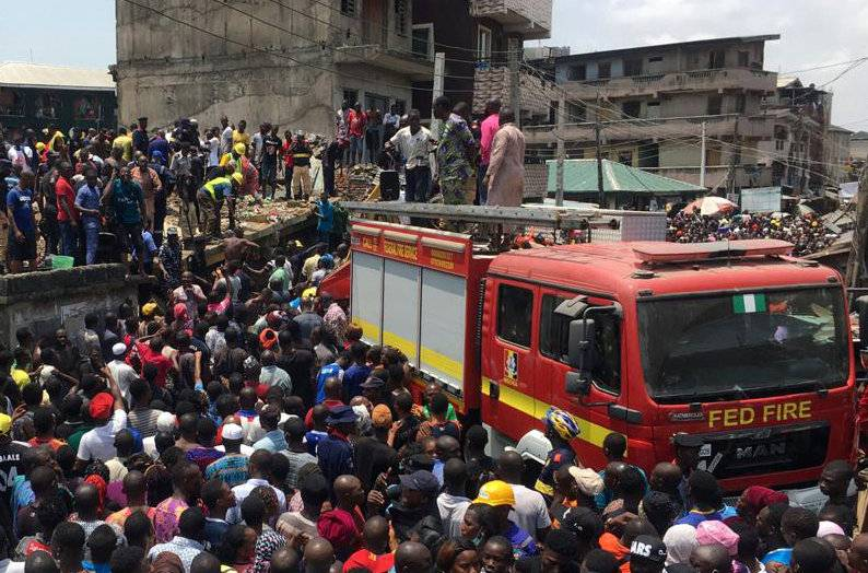 Rescue workers are seen at the site of a collapsed building containing a school in Nigeria's commercial capital of Lagos