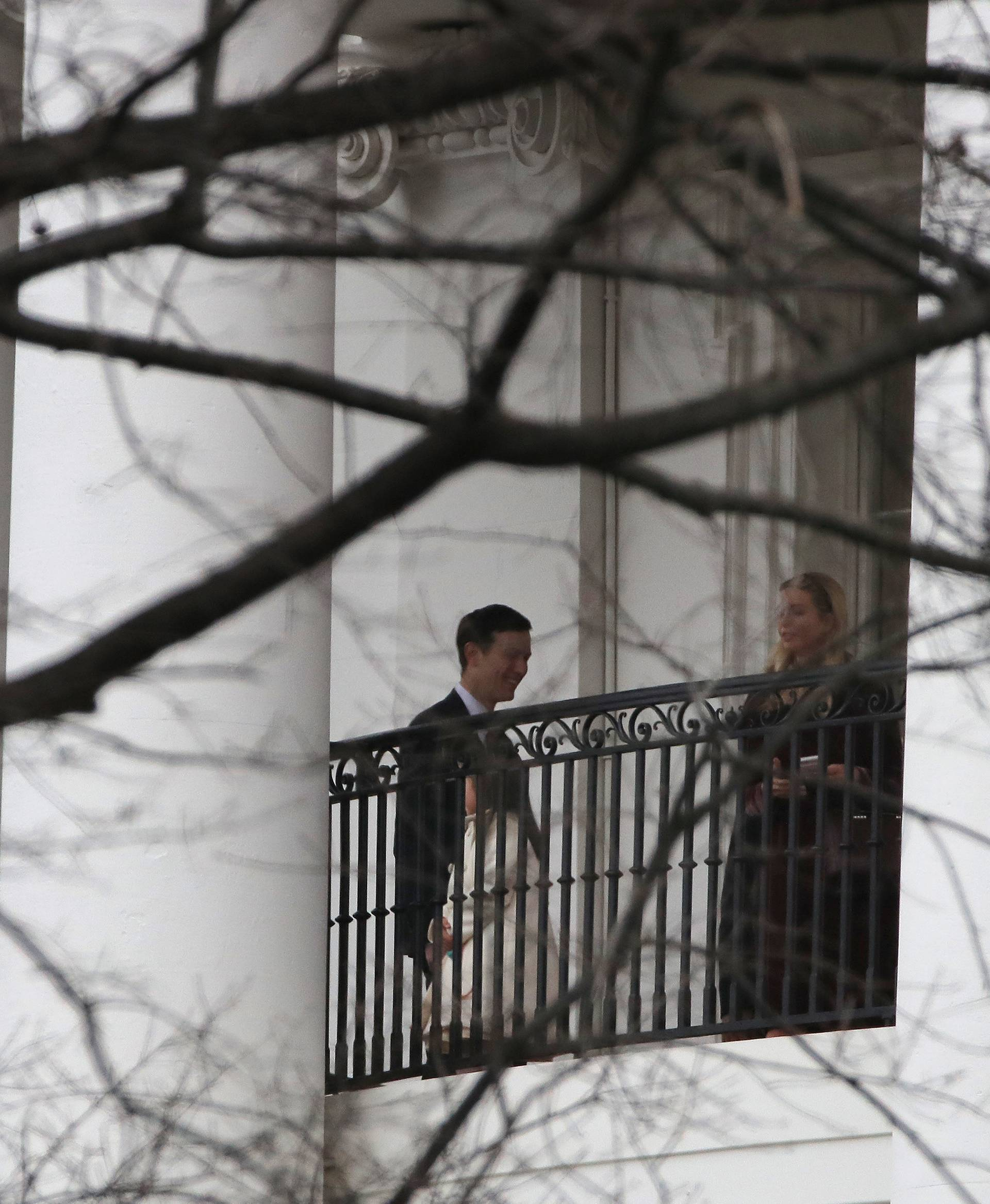 Ivanka Trump, her husband, Jared Kushner and their daughter Arabella stand on a balcony of the White House before departure for a church service in Washington, U.S.
